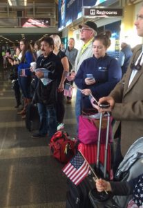 Airport travelers at Ronald Reagan National Airport gathered to welcome Veterans as they arrived on a Honor Flight in DC.